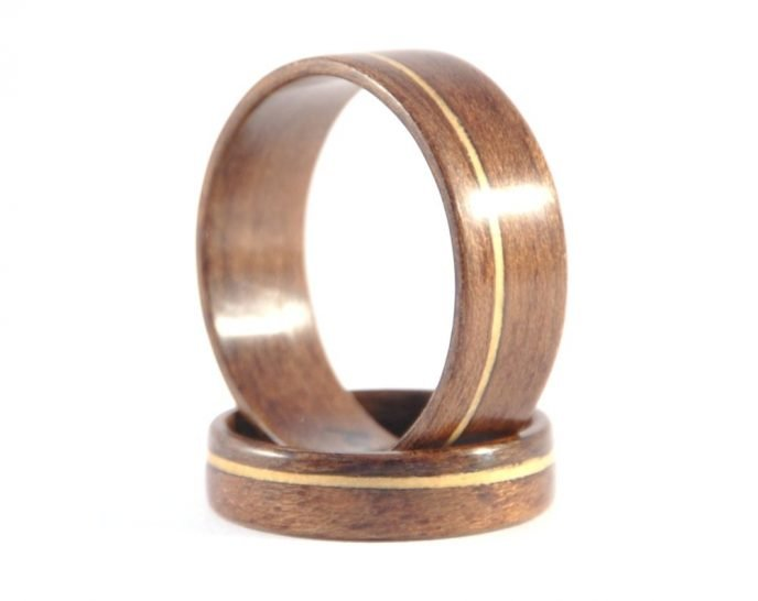 QLD walnut and huon pine matching wedding rings - one ring supporting the other