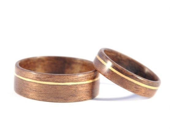 QLD walnut and huon pine matching wedding rings - lying