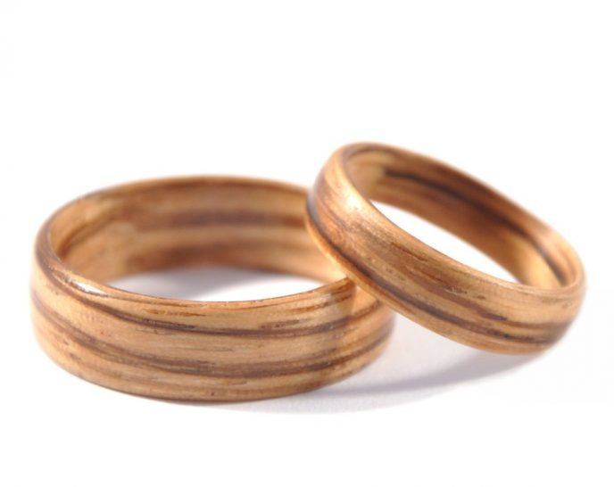 Zebra wood wedding ring set - lying