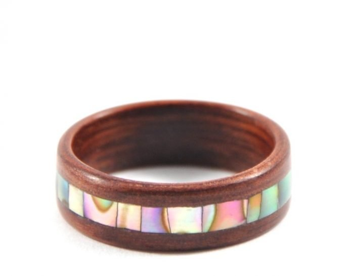 Jarrah wooden ring with abalone seashell inlay - laying flat